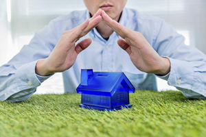Man hands covering a model home